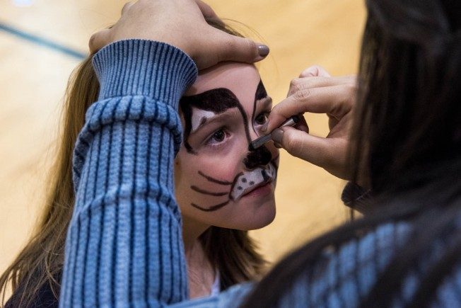 AJ Purdie, a 4th grader at Highland Park Elementary, getting her face painted.