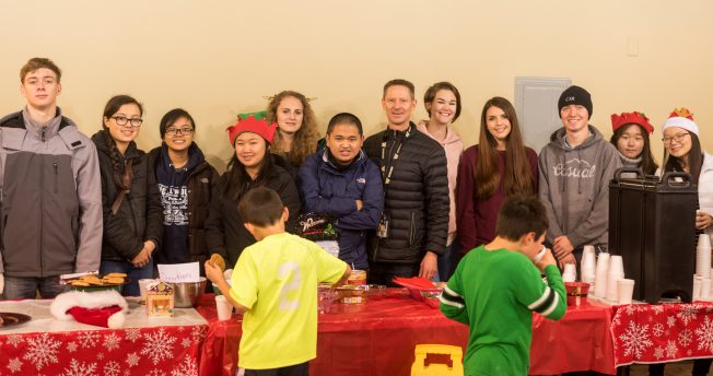 John Hasslinger, center, the Teen Development Leader for Seattle Parks and Rec. surrounded by his volunteers from the Hiawatha Community Center.